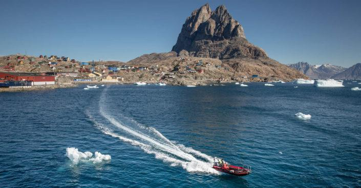 A tender boat from cruise ship MS Fram leaving Uummannaq in North Greenland