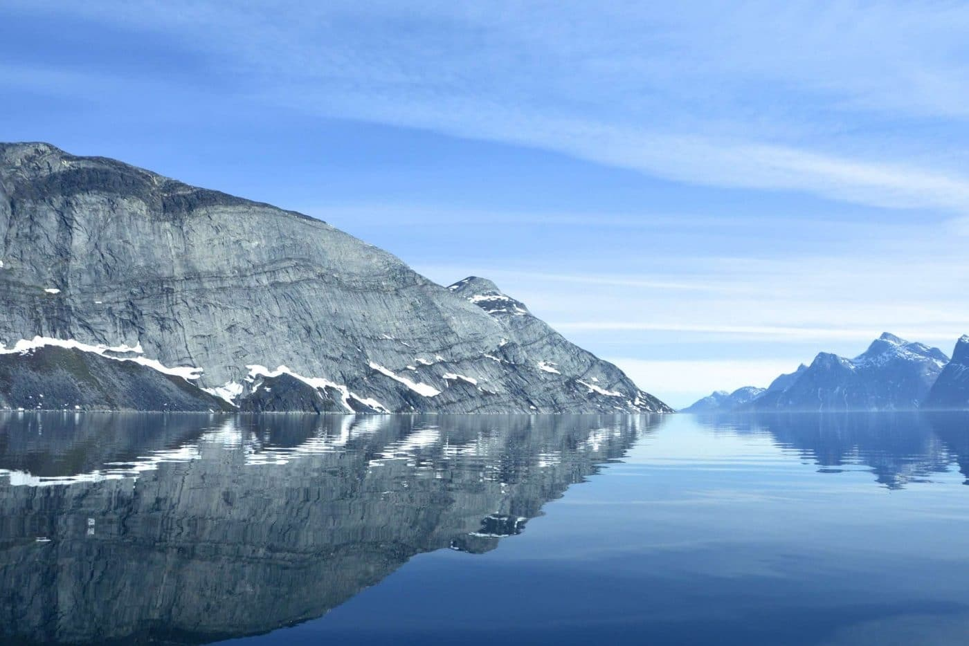 Reflections of mountains in Nuuk Fjord on a sunny day. Photo by Nuuk Water Taxi
