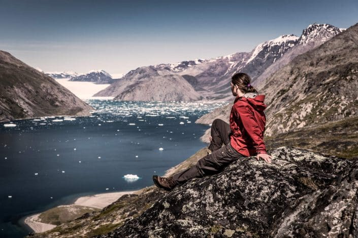 A hiker overlooking Qooroq ice fjord in South Greenland near Narsarsuaq. Photo by Mads Pihl.