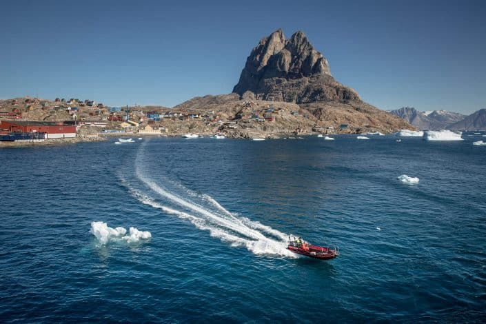 A tender boat between Uummannaq and MS Fram in Greenland. Photo by Mads Pihl.