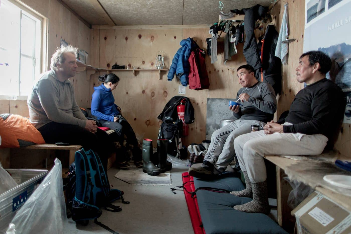 Dog mushers in the Travellodge Greenland hut near Sermilik in East Greenland. By Mads Pihl