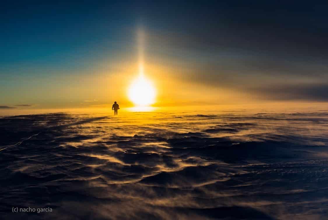 Sharp sun and silhouette on inland ice. By Nacho Garcia