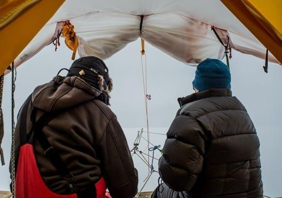 Ramón and Miguel busy steering the sled. For several days we almost had a complete 'white-out'. By Malik Milfeldt