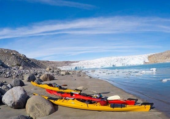 Kayaks and glacier. By Visit Greenland