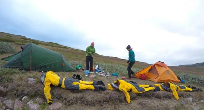 Sloppy campsite and drying drysuits. By Visit Greenland