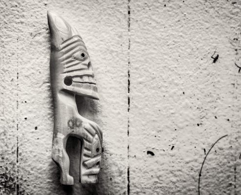 A bone carving figurine from Tasillaq in East Greenland looking right. By Mads Pihl