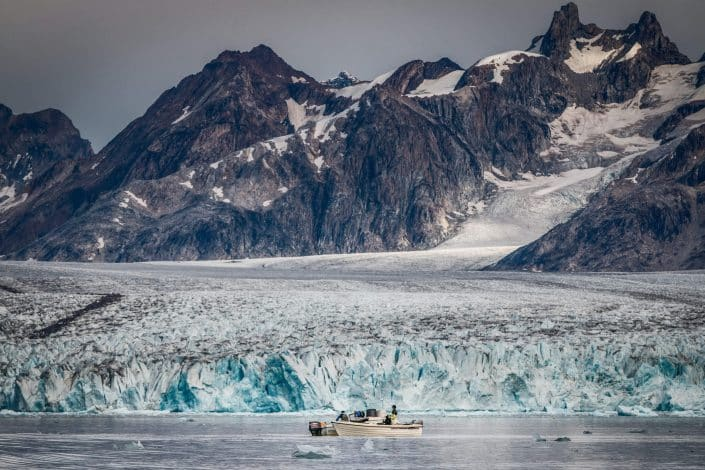 Two fishermen working near the front of the Knud Rasmussen glacier in East Greenland. By Mads Pihl