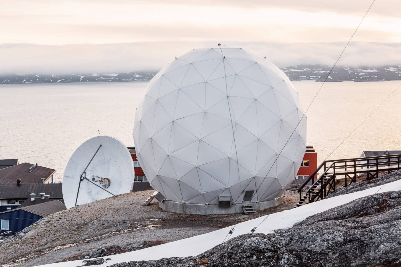 Tele-Post's radome screen with the mountains and sea in the background, in Nuuk. Photo by Filip Gielda