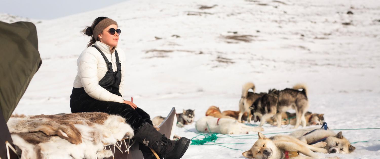 Musher Taking Break in Sun. Photo - Aningaaq R. Carlsen, Visit Greenland