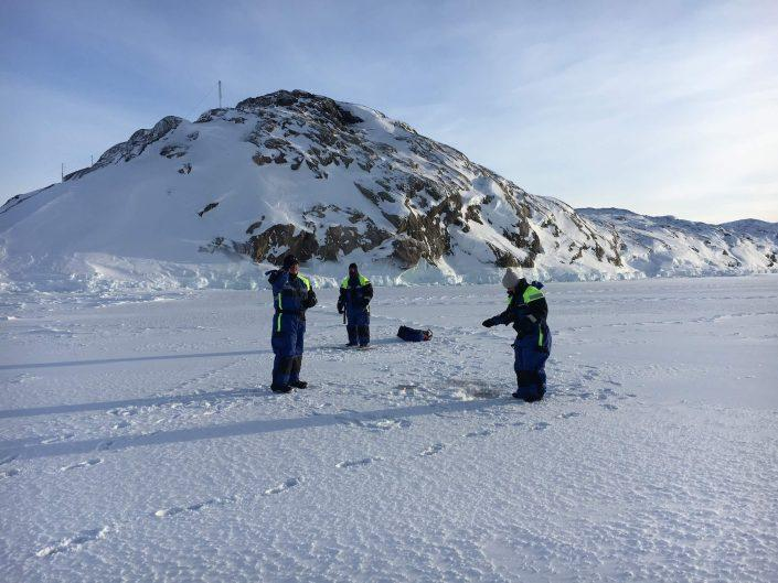 Local guides and tourist ice fishing in Ilulissat. Photo by Ilulissat Water Safari