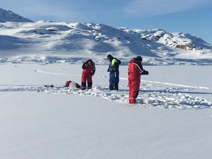 Local guides and tourist ice fishing. Photo by Ilulissat Water Safari