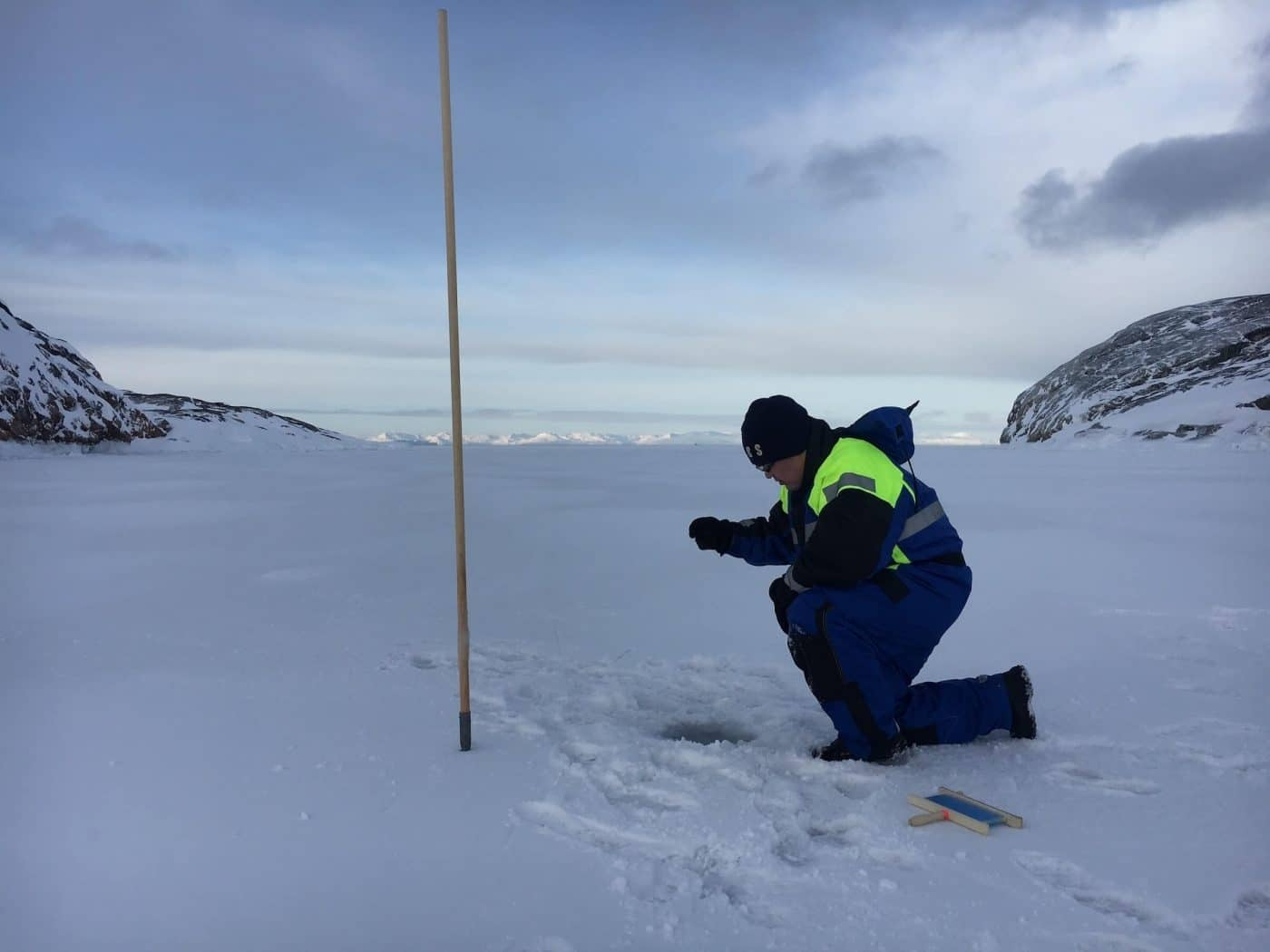 Local guide ice fishing in Ilulissat. Photo by Ilulissat Water Safari