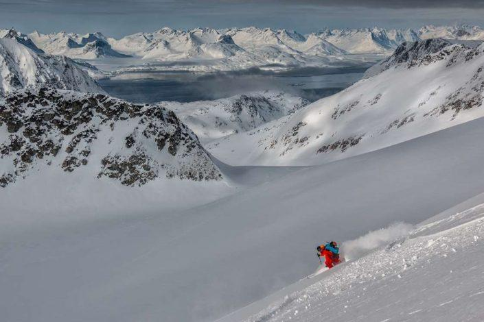 Skier skiing downhill in East Greenland. Photo by Pirhuk - Greenland Expedition Specialists