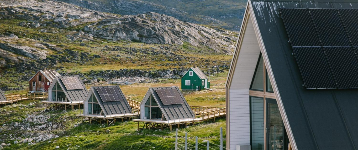 Some of the 15 sustainable huts that make up the Ilimanaq lodge- close up. Photo by Jessie Brinkman Evans