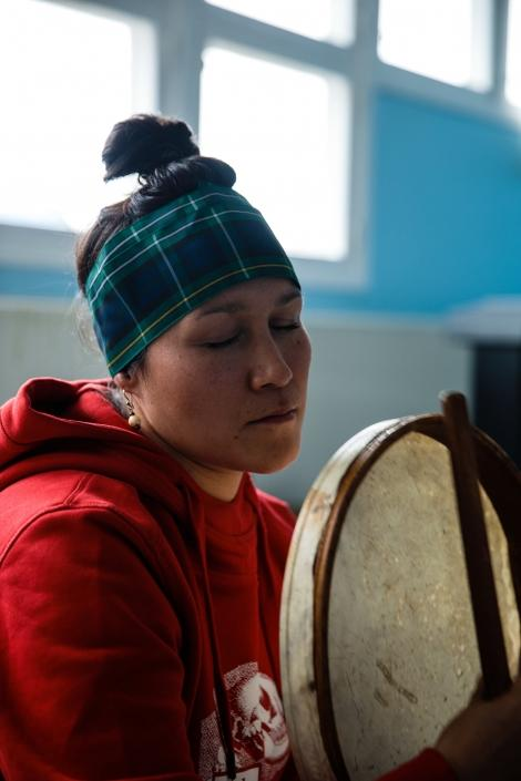 Artist Varna Marianne Nielsen during a drum song. Photo by Jessie Brinkman Evans