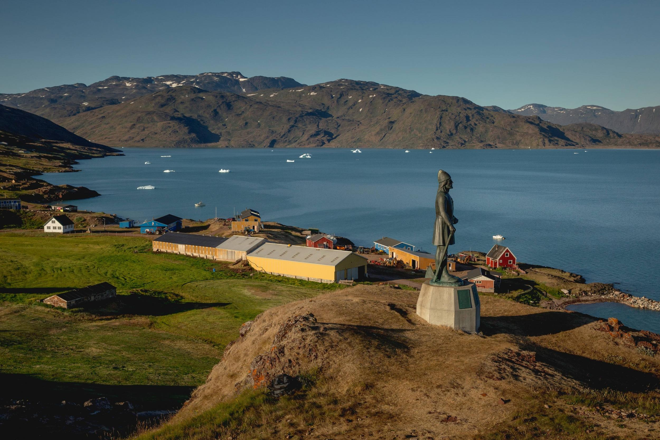 Looking out over Qassiarsuk in South Greenland with the statue of Leif Ericson in the foreground. Photo by Mads Pihl