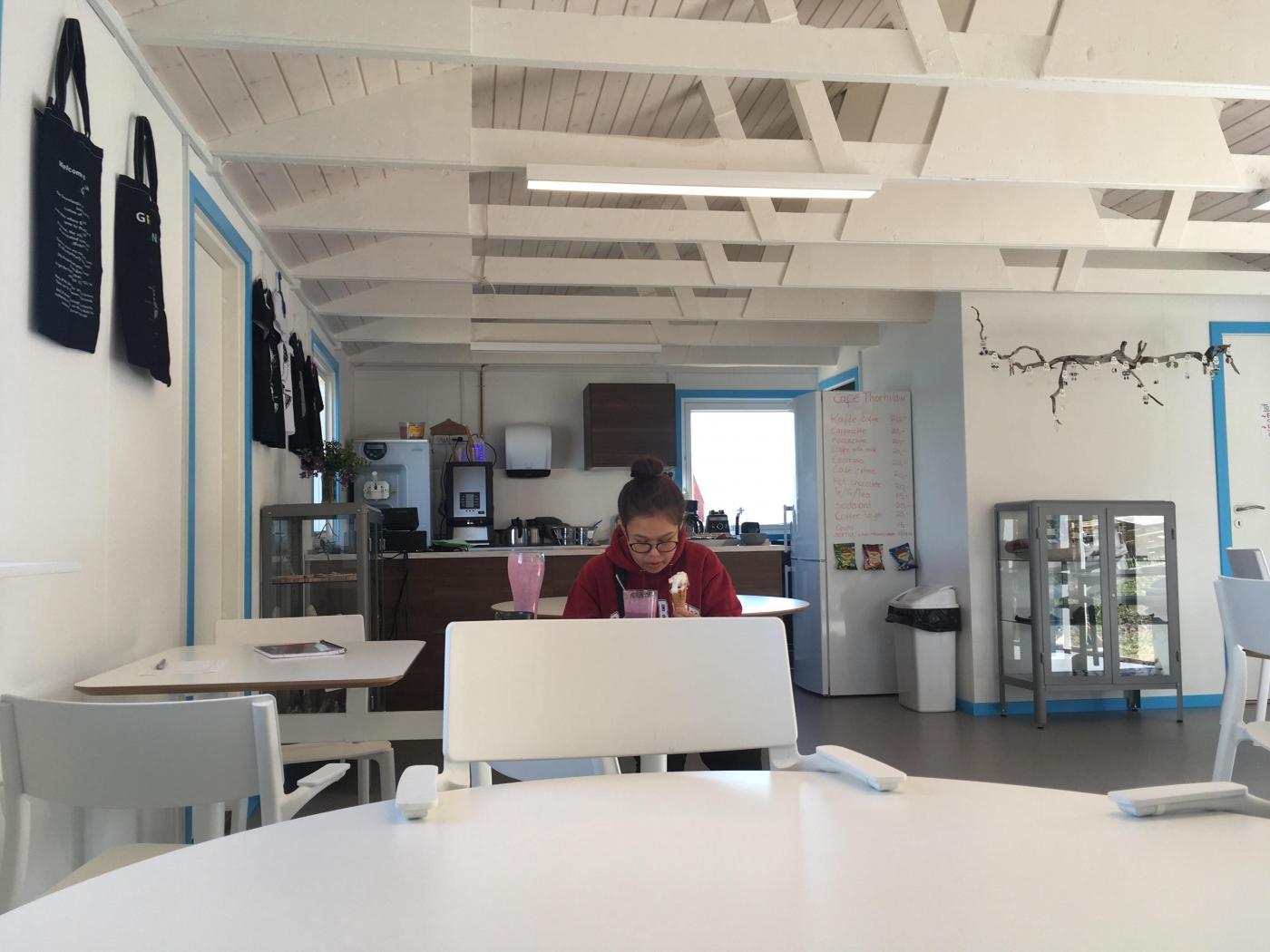 Cafe Thorhildur woman drinking smoothie while eating an ice cream. Visit Greenland