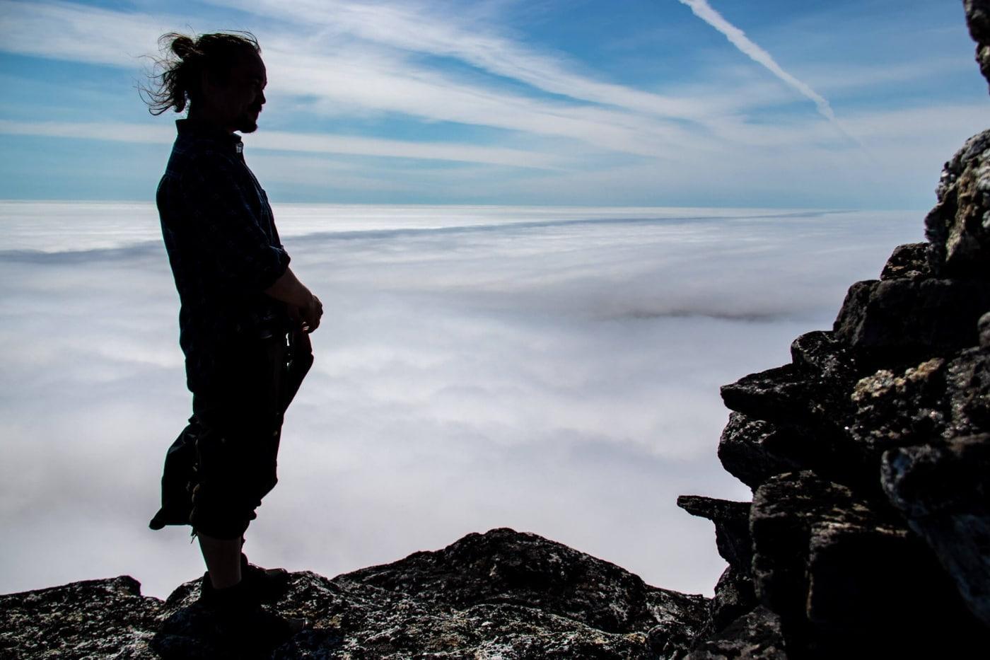 Local guide Salik Frederiksen looks over a Nanortalik shrouded in cloud. Photo by Iris Timmermans - Visit Greenland
