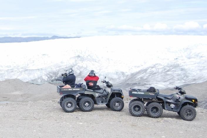 North Safari Travel tour tourists on ATV photographing glacier. Photo by North Safari Travel
