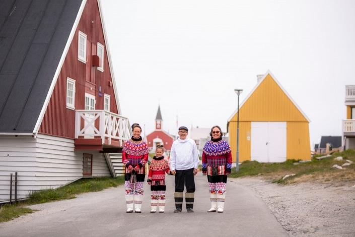 The Family In Their National Clothing. National Clothing. National Day Gathering By The Old Harbour. Photo by Aningaaq R Carlsen - Visit Greenland