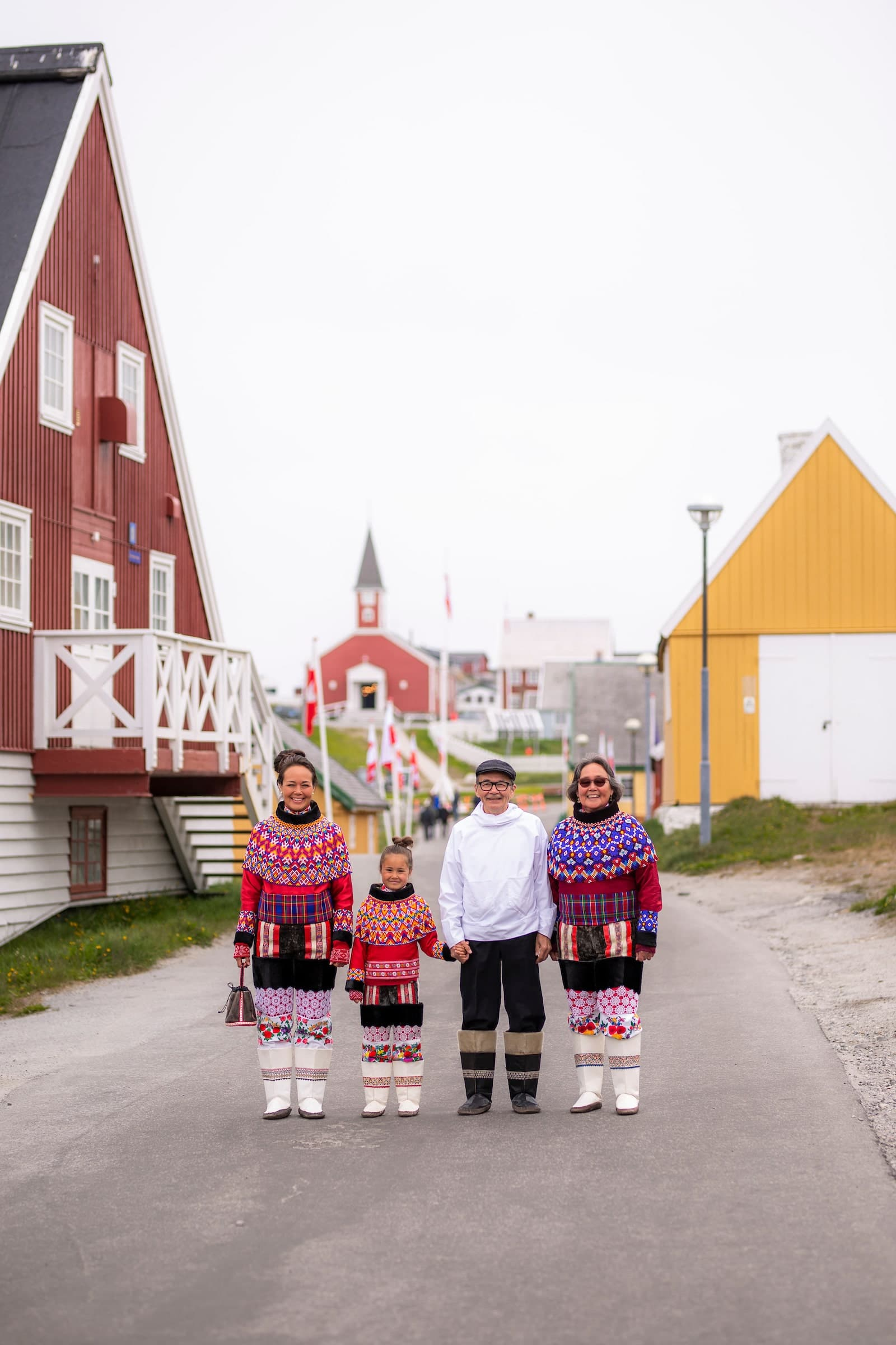 The National Day In Their National Clothings. The Family In Their National Clothing. National Clothing. National Day Gathering By The Old Harbour. Photo by Aningaaq R Carlsen - Visit Greenland