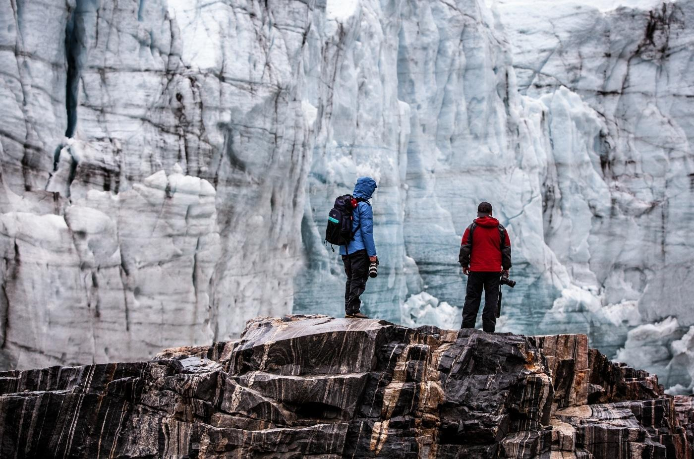Two photographers on a photo tour by the Russell Glacier in Greenland. Photo by Mads Pihl, Visit Greenland
