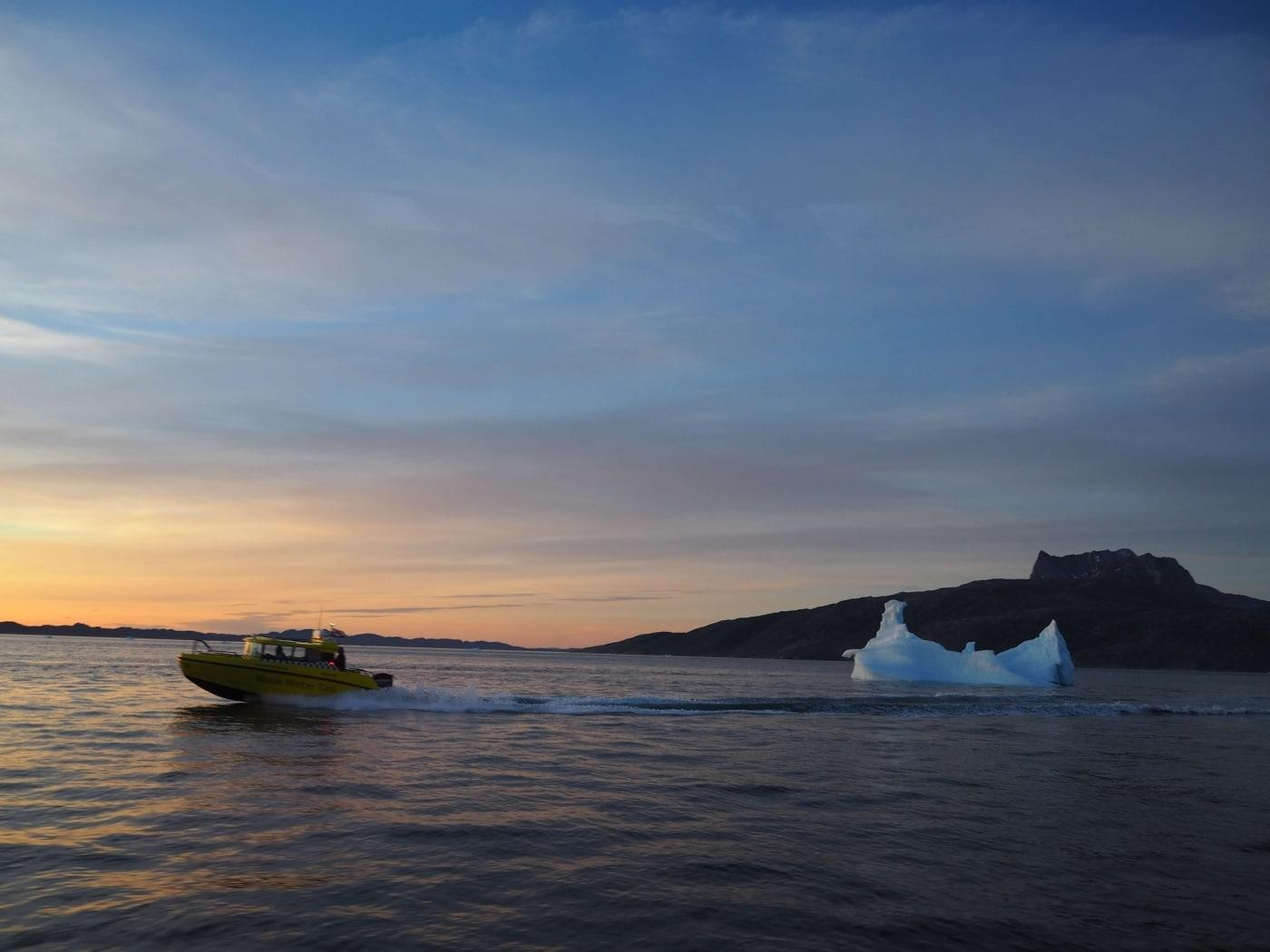 Speed boat during sunset.