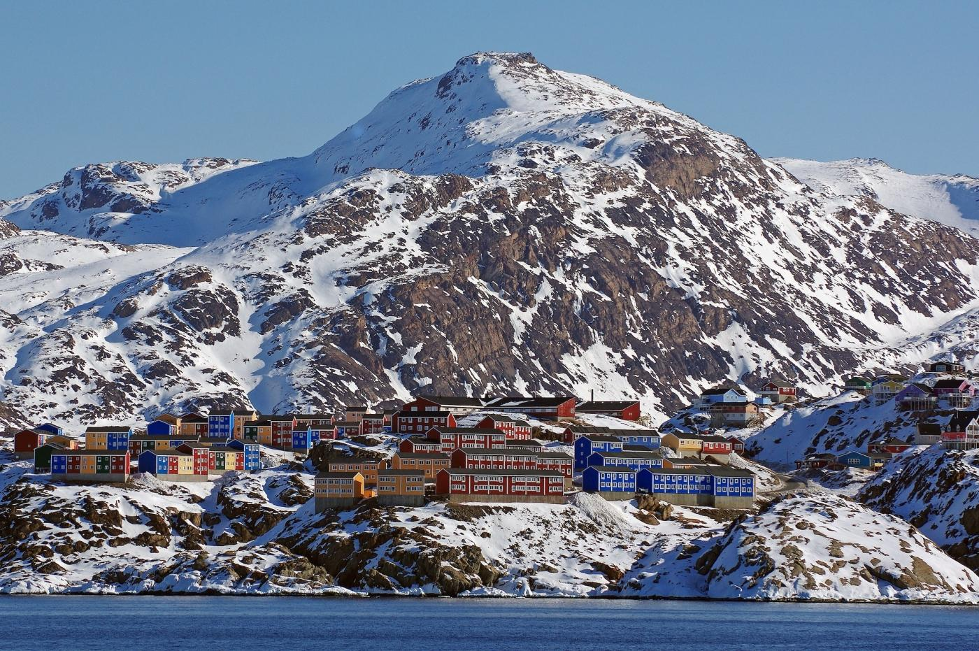 Colourful houses stand out against the winter landscape in Sisimiut, Destination Arctic Circle. Photo by Reinhard Pantke - Visit Greenland.