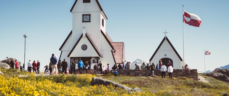 A sunny day at the Nanortalik church in South Greenland. Photo by Mads Pihl - Visit Greenland