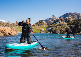 Two SUP with Sisimiut in the back. Photo - Aningaaq R. Carlsen, Visit Greenland