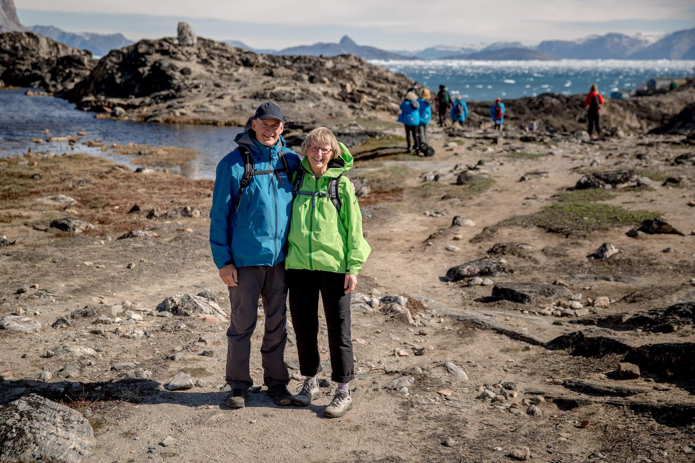 A couple hiking outside Uummannaq in Greenland. By Mads Pihl