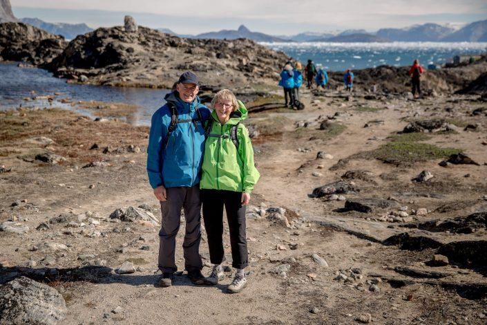 A couple hiking outside Uummannaq in Greenland. Photo by Mads Pihl