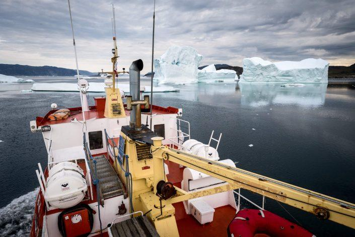A Disko Line tour boat near icebergs in the Disko bay in Greenland