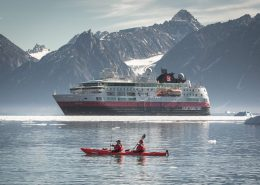 A double kayak in front of MS Fram in North Greenland near Illorsuit