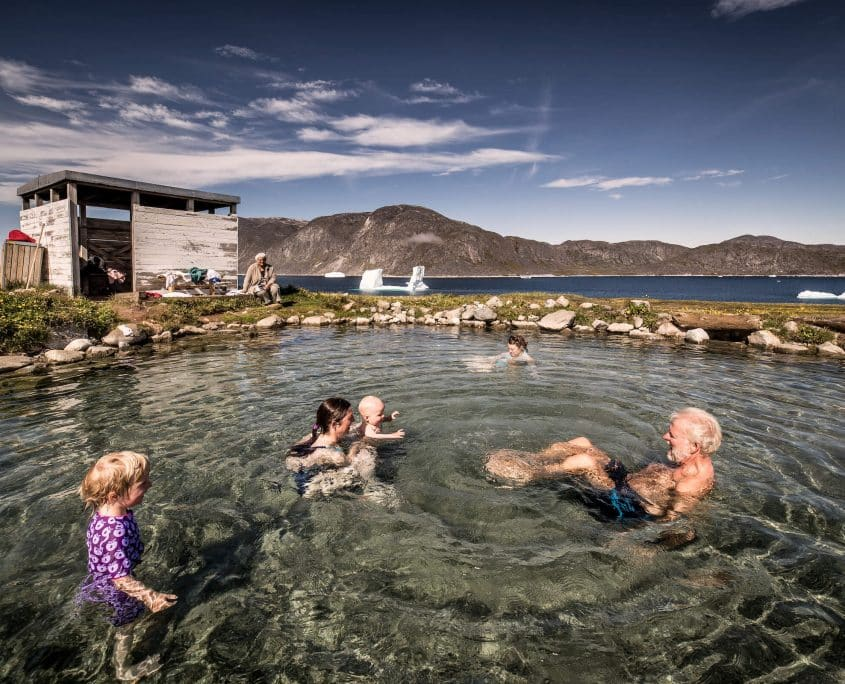 A family enjoying the Uunartoq hot springs in South Greenland. By Mads Pihl