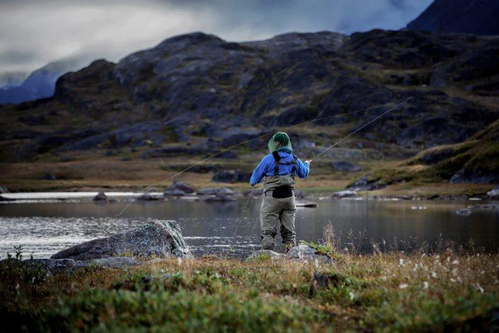 Fly fishing on Erfalik river in Destination Arctic Circle in West Greenland. By Mads Pihl