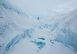 A glacier walking adventure by a crevasse on the Greenland Ice Sheet near Kangerlussuaq. By Paul Zizka
