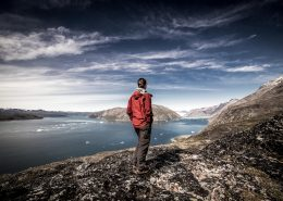 A hiker looking north towards Narsarsuaq on the Qooroq ice fjord. By Mads Pihl