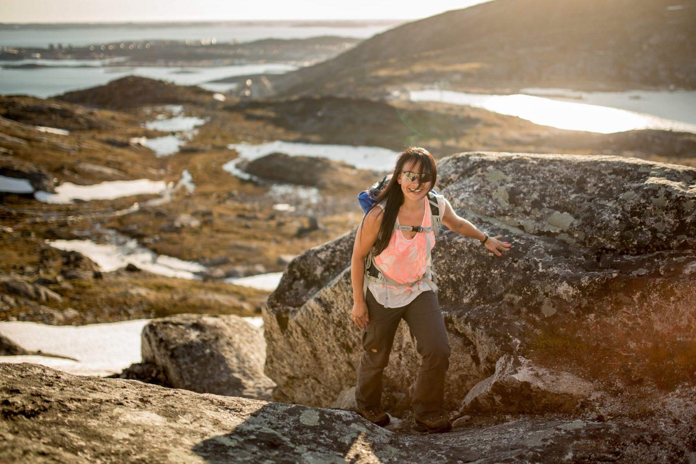 A hiker on the first part of the climb to the Ukkusissaq - Store Malene peak outside Nuuk in Greenland