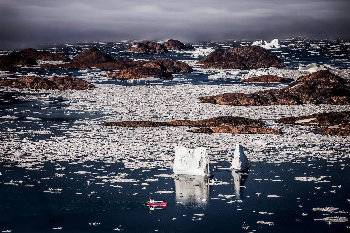 A Royal Arctic Line supply ship in the archipelago near Kulusuk in East Greenland. By Mads Pihl