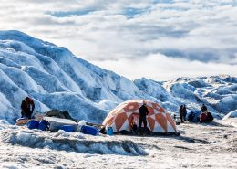 Adventurers settling in at Camp Ice Cap on the Greenland Ice Sheet, run by Albatros Arctic Circle in Kangerlussuaq. Photo by Raven Eye Photography