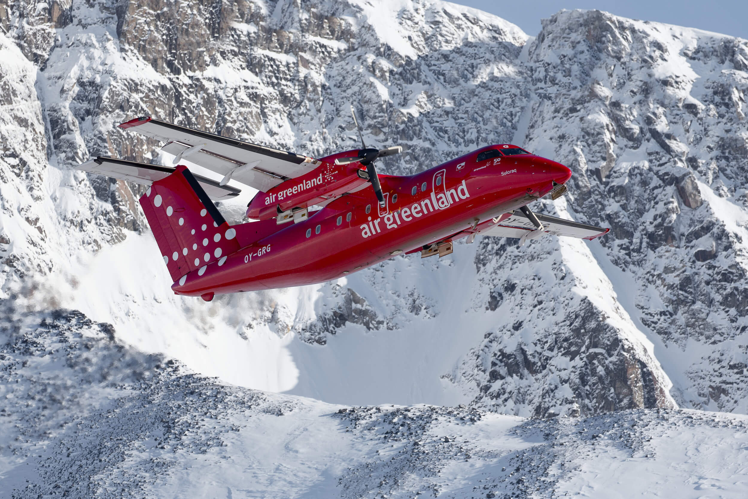 An Air Greenland Dash-8 taking off from Kulusuk in East Greenland. Photo by Mads Pihl