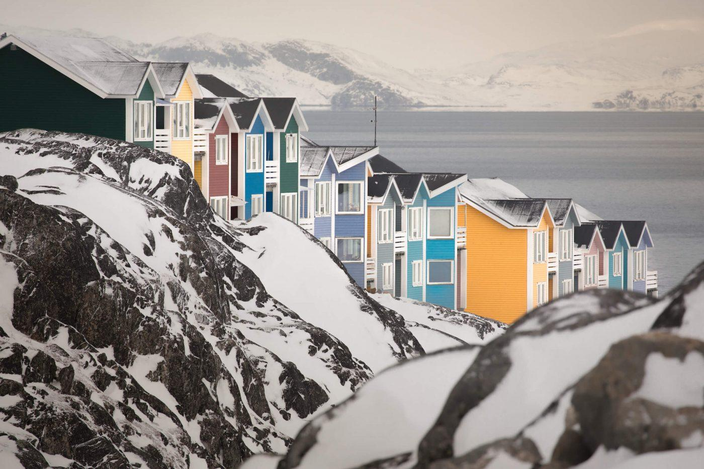 Architechture - Pastel coloured houses in Nuuk hugging the hillsides in Greenland