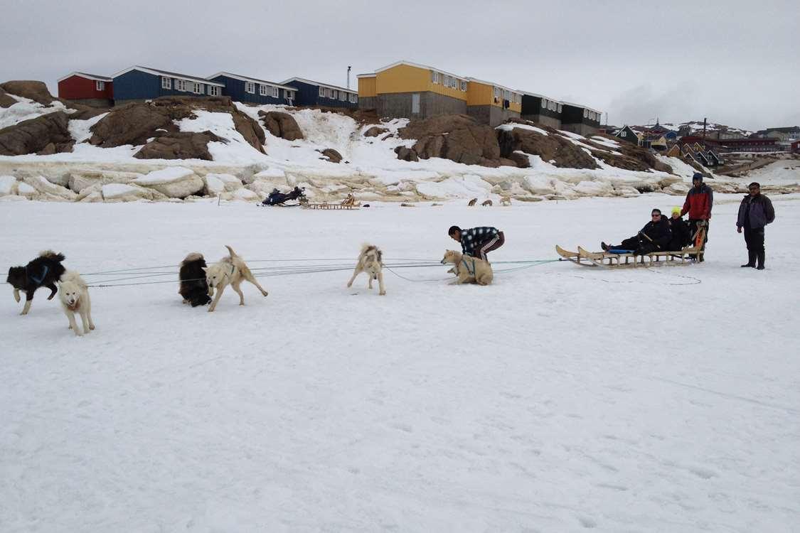 People on a dog sled leaving from Kulusuk, going to Apusiajik ('Little' glacier). Photo by Arctic Wonderland Tours, Visit GreenlandArctic Wonderland Tours 03
