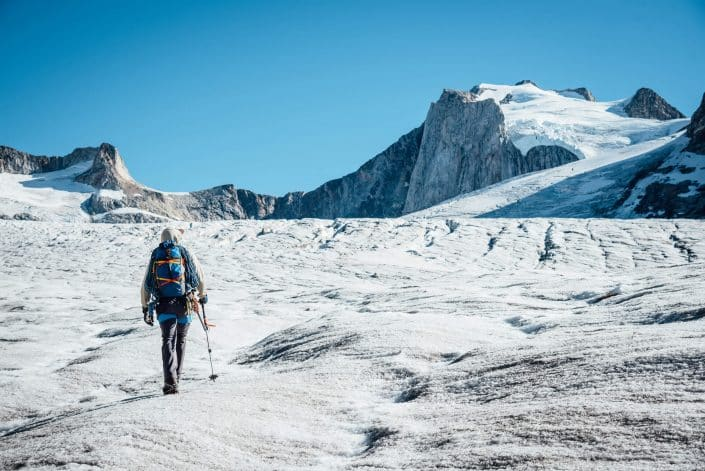 Climber on a glacier walking, East Of Tasiilaq Fjord. By Chris Brinlee Jr