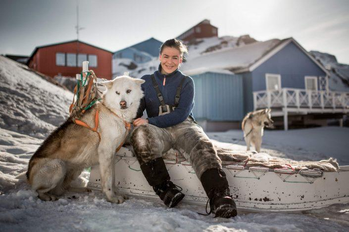 Dog sledder Navarana Lennert from Sisimiut with one of her dogs in downtown Sisimiut in Greenland