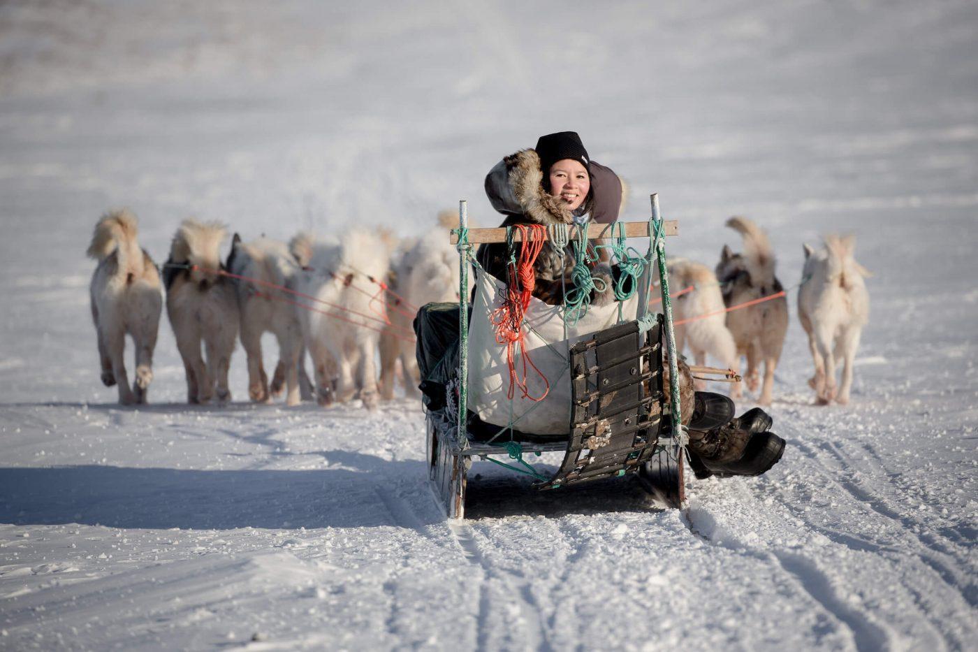 Dog sledding on the trails outside Ilulissat in Greenland