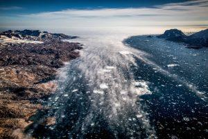 Fog creeping in to the Sermilik ice fjord in East Greenland seen from an Air Zafari flight. By Mads Pihl