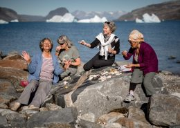 Four women sharing a meal on the rocks near Narsaq in South Greenland