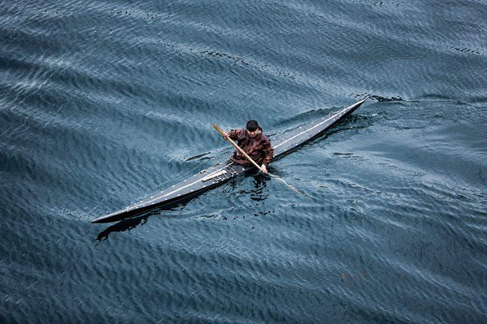 A kayaker from Sisimiut in Greenland in a traditional skin kayak. Photo by Mads Pihl, Visit Greenland